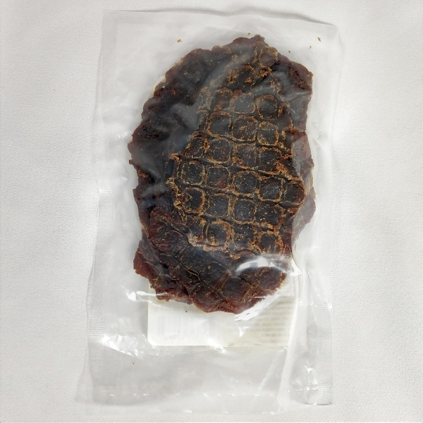 back of jerky bag showing meat texture